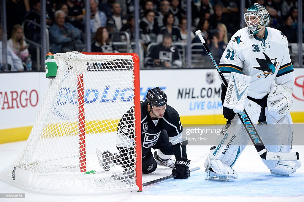 Antti Niemi #31 of the San Jose Sharks looks back in the net for Kyle Clifford #13 of the Los Angeles Kings during the second period at Staples Center on October 8, 2014 in Los Angeles, California.