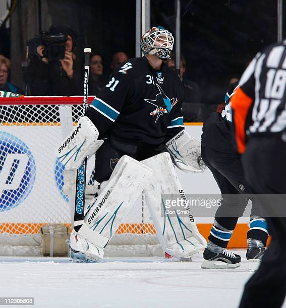 Antti Niemi of the San Jose Sharks looks for the puck against the Los Angeles Kings in Game One of the Western Conference Quarterfinals during the...