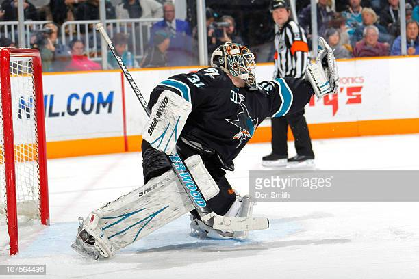 Antti Niemi of the San Jose Sharks makes a glove save against the Dallas Stars during an NHL game on December 13 2010 at HP Pavilion at San Jose in...
