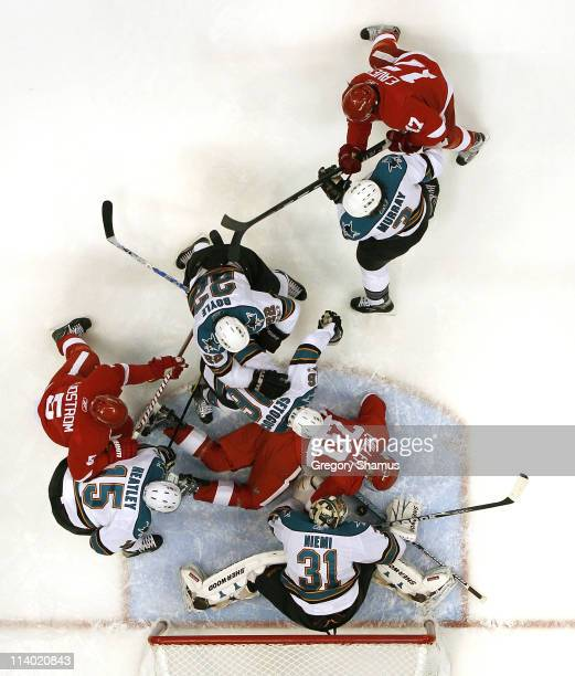 Antti Niemi of the San Jose Sharks makes a save in front of Drew Miller of the Detroit Red Wings in Game Six of the Western Conference Semifinals...