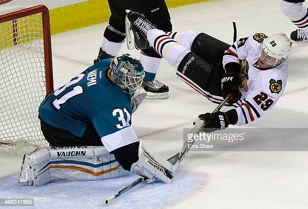 Antti Niemi of the San Jose Sharks makes a save on a shot taken by Bryan Bickell of the Chicago Blackhawks at SAP Center on March 14 2015 in San Jose...