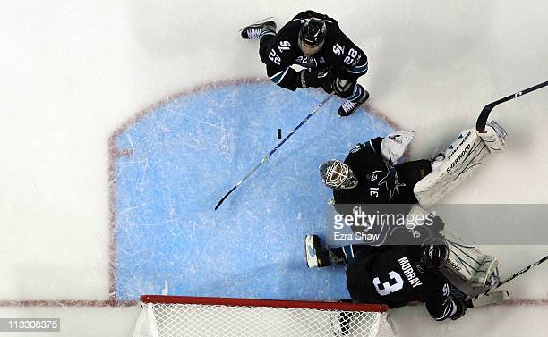 Antti Niemi of the San Jose Sharks makes a save with the help of Douglas Murray and Dan Boyle during their game against the Detroit Red Wings in Game...