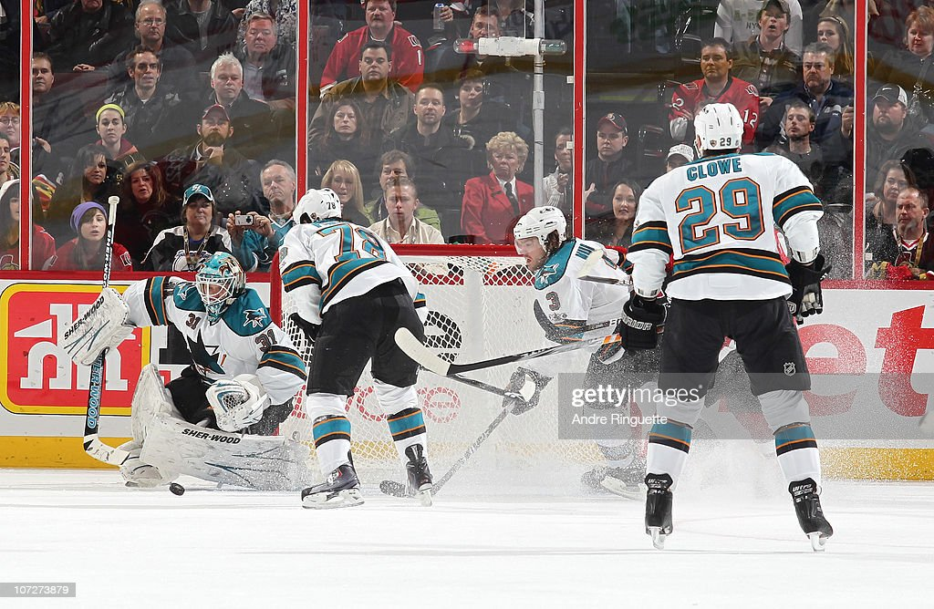 Antti Niemi #31 of the San Jose Sharks makes one of his saves on his way to a shutout against the Ottawa Senators as teammates Benn Ferriero #78, Douglas Murray #3 and Ryane Clowe #29 support at Scotiabank Place on December 2, 2010 in Ottawa, Ontario, Canada.