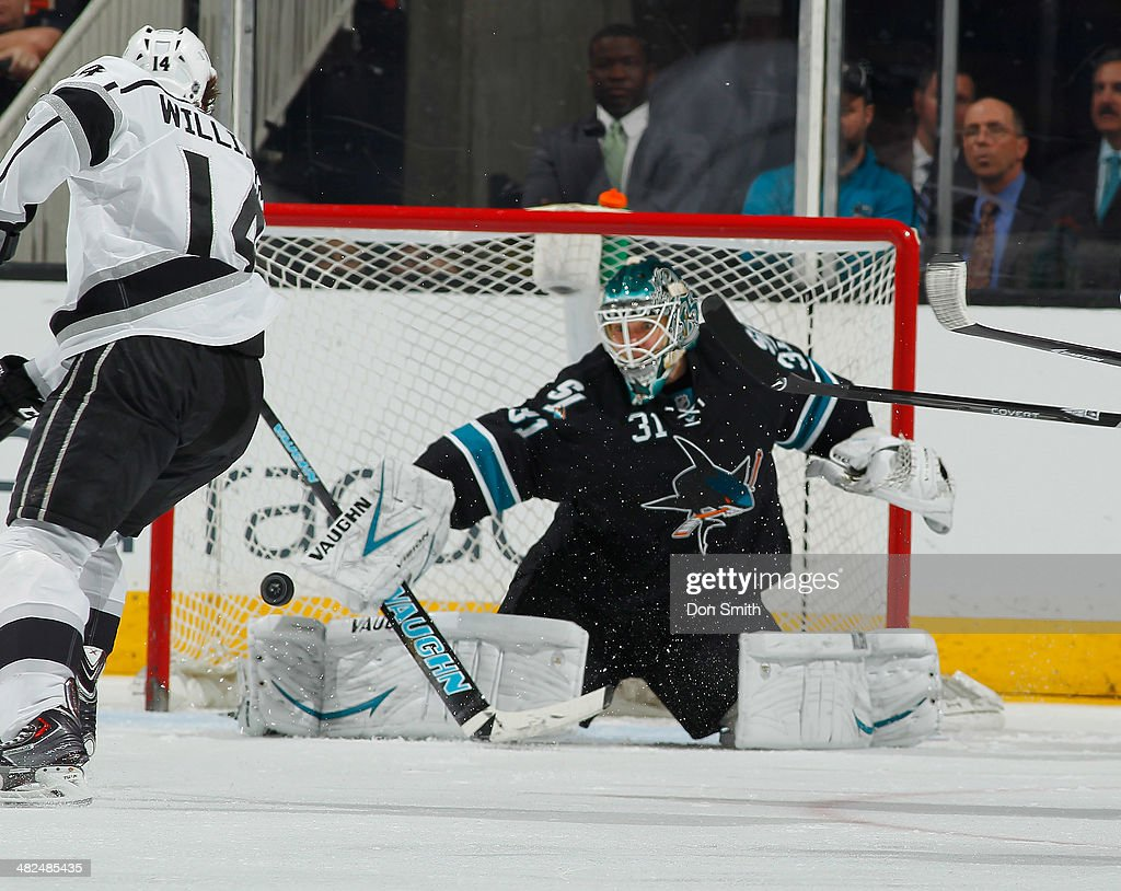 Antti Niemi #31 of the San Jose Sharks protects the net against Justin Williams #14 of the Los Angeles Kings during an NHL game on April 3, 2014 at SAP Center in San Jose, California.