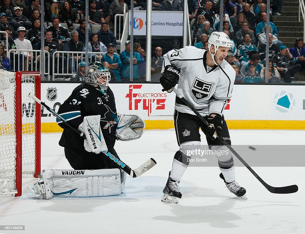 Antti Niemi #31 of the San Jose Sharks protects the net against Kyle Clifford #13 of the Los Angeles Kings during an NHL game on April 3, 2014 at SAP Center in San Jose, California.