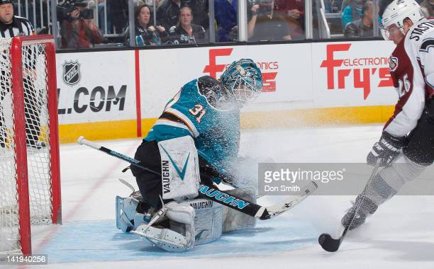 Antti Niemi of the San Jose Sharks protects the puck against Paul Stastny of the Colorado Avalanche at HP Pavilion on March 26 2012 in San Jose...