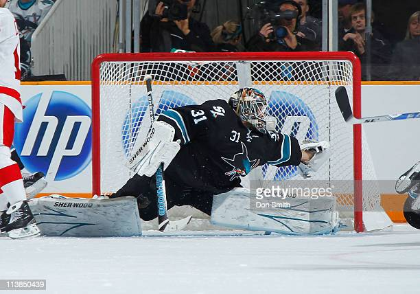Antti Niemi of the San Jose Sharks stretches for a glove save against the Detroit Red Wings in Game Five of the Western Conference Semifinals during...