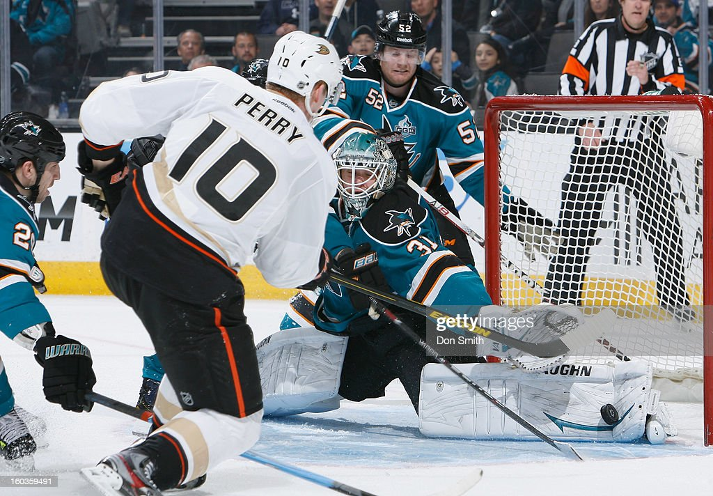 Antti Niemi #31 of the San Jose Sharks stretches out for a save against Corey Perry #10 of the Anaheim Ducks during an NHL game on January 29, 2013 at HP Pavilion in San Jose, California.
