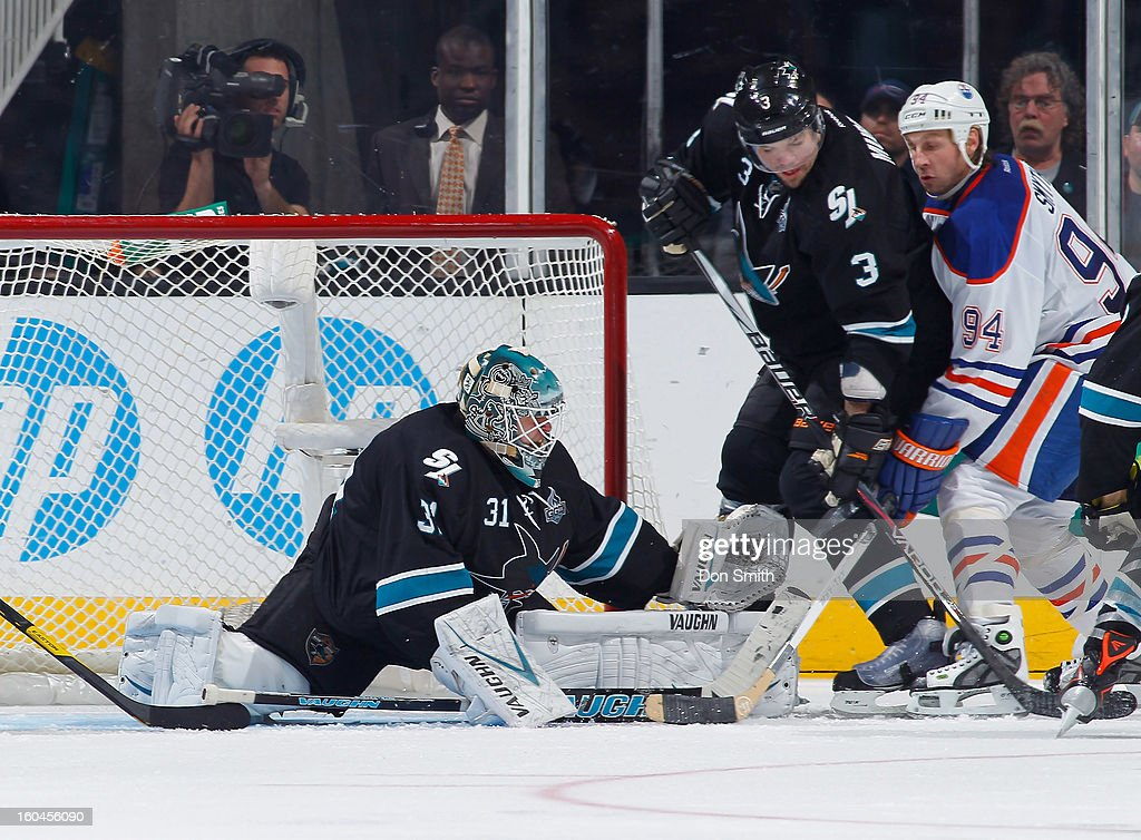 Antti Niemi #31 of the San Jose Sharks stretches out for a save against Ryan Smyth #94 of the Edmonton Oilers during an NHL game on January 31, 2013 at HP Pavilion in San Jose, California.
