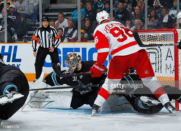 Antti Niemi of the San Jose Sharks stretches out for the save against Tomas Holmstrom of the Detroit Red Wings in Game Five of the Western Conference...