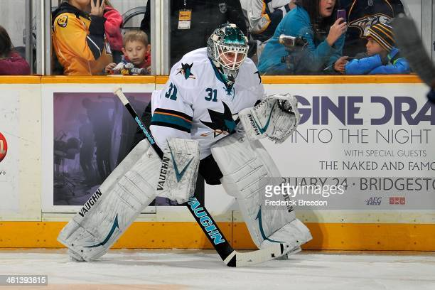 Antti Niemi of the San Jose Sharks warms up prior to a game against the Nashville Predators at Bridgestone Arena on January 7 2014 in Nashville...