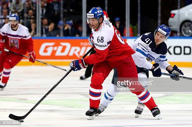 Antti Pihlstrom of Finland and Jaromir Jagr of Czech Republic battle for the puck during the IIHF World Championship quarter final match between...