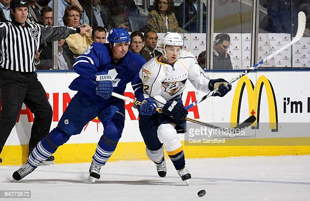 Antti Pihlstrom of Nashville Predators battles for the puck with Tomas Kaberle of the Toronto Maple Leafs during their NHL game at the Air Canada...