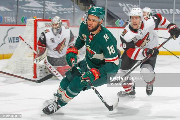 Antti Raanta and Ilya Lyubushkin of the Arizona Coyotes defend against Jordan Greenway of the Minnesota Wild during the game at the Xcel Energy...