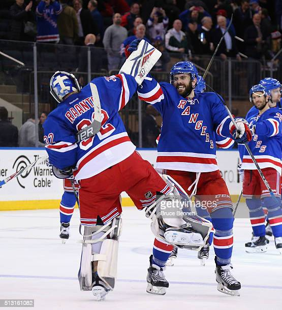 Antti Raanta and Keith Yandle of the New York Rangers celebrate the Rangers 21 victory against the Columbus Blue Jackets at Madison Square Garden on...