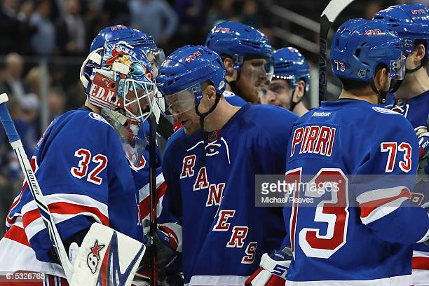 Antti Raanta celebrates with Michael Grabner of the New York Rangers after they defeated the San Jose Sharks 74 at Madison Square Garden on October...