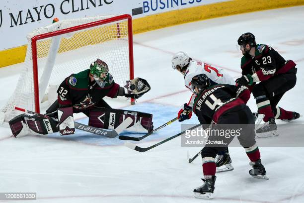 Antti Raanta of the Arizona Coyotes catches the puck in the first period against the Washington Capitals at Gila River Arena on February 15 2020 in...