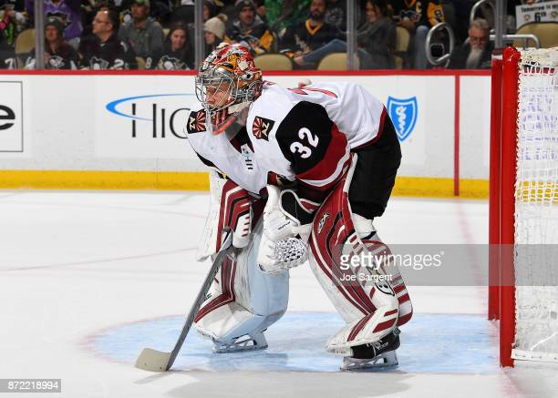 Antti Raanta of the Arizona Coyotes defends the net against the Pittsburgh Penguins at PPG Paints Arena on November 7 2017 in Pittsburgh Pennsylvania