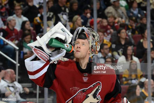 Antti Raanta of the Arizona Coyotes gets a drink during a stop in play against the Pittsburgh Penguins at Gila River Arena on December 16 2017 in...