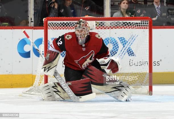 Antti Raanta of the Arizona Coyotes gets ready to make a save against the Calgary Flames at Gila River Arena on March 19 2018 in Glendale Arizona