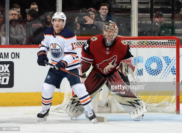 Antti Raanta of the Arizona Coyotes gets ready to make a save while looking around a screen by Michael Cammalleri of the Edmonton Oilers at Gila...