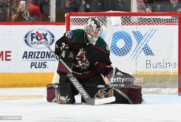 Antti Raanta of the Arizona Coyotes makes a glove save against the Colorado Avalanche at Gila River Arena on November 23 2018 in Glendale Arizona