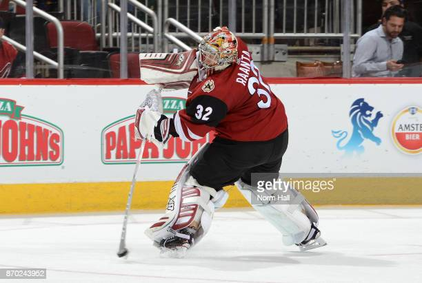 Antti Raanta of the Arizona Coyotes passes the puck up ice against the Buffalo Sabres at Gila River Arena on November 2 2017 in Glendale Arizona