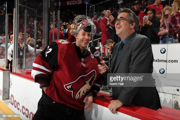 Antti Raanta of the Arizona Coyotes talks with Todd Walsh of Fox Sports Arizona after a 32 overtime win against the Nashville Predators at Gila River...