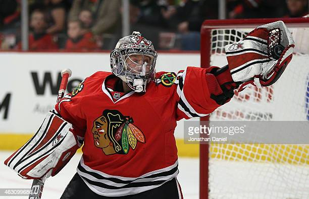 Antti Raanta of the Chicago Blackhawks makes a glove save against the Arizona Coyotes at the United Center on February 9 2015 in Chicago Illinois
