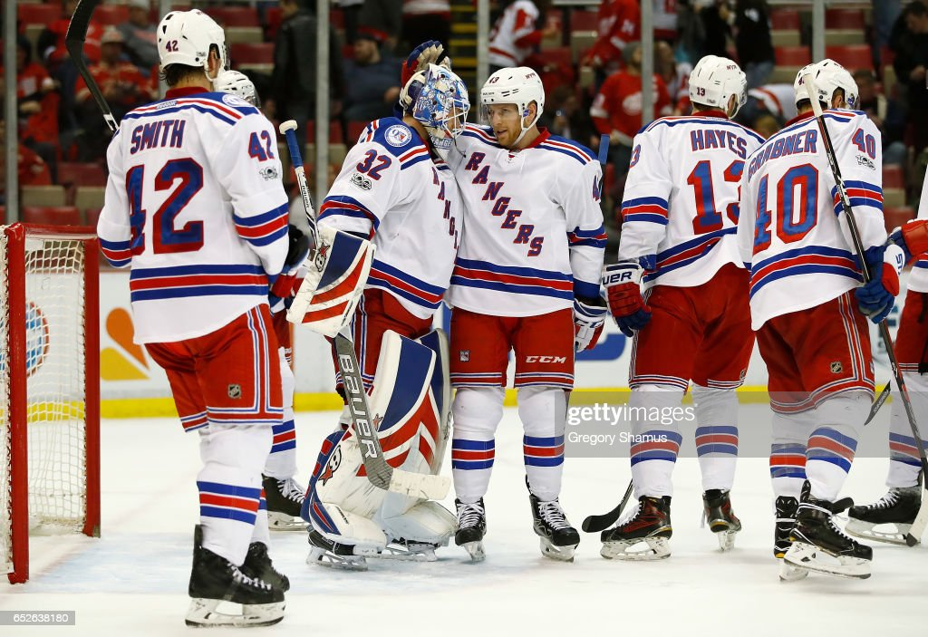 Antti Raanta #32 of the New York Rangers celebrate a 4-1 win over the Detroit Red Wings with Steven Kampfer #43 at Joe Louis Arena on March 12, 2017 in Detroit, Michigan.