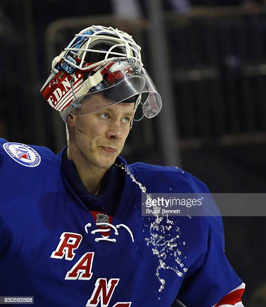 Antti Raanta of the New York Rangers expels water during the first period against the Ottawa Senators at Madison Square Garden on December 27 2016 in...