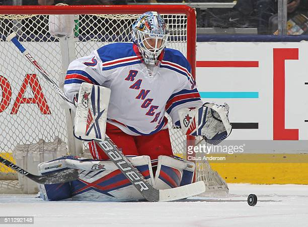 Antti Raanta of the New York Rangers gets set to stop a bouncing puck against the Toronto Maple Leafs during an NHL game at the Air Canada Centre on...