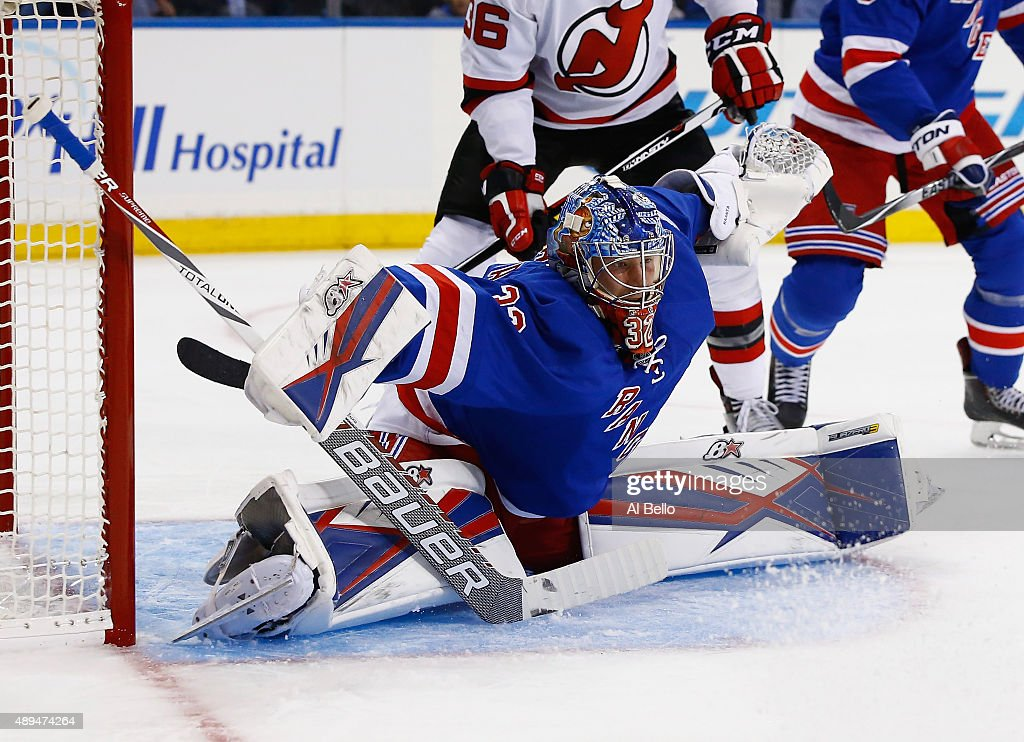 Antti Raanta #32 of the New York Rangers makes a save against the New Jersey Devils during their Pre Season game at Madison Square Garden on September 21, 2015 in New York City.