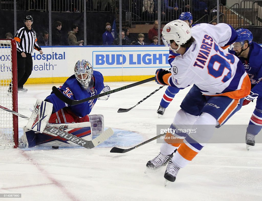 Antti Raanta #32 of the New York Rangers makes the save on John Tavares #91 of the New York Islanders at Madison Square Garden on March 6, 2016 in New York City. The Islanders defeated the Rangers 6-4.