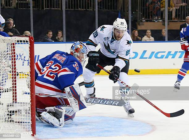 Antti Raanta of the New York Rangers makes the third period save as Barclay Goodrow of the San Jose Sharks looks for the rebound at Madison Square...