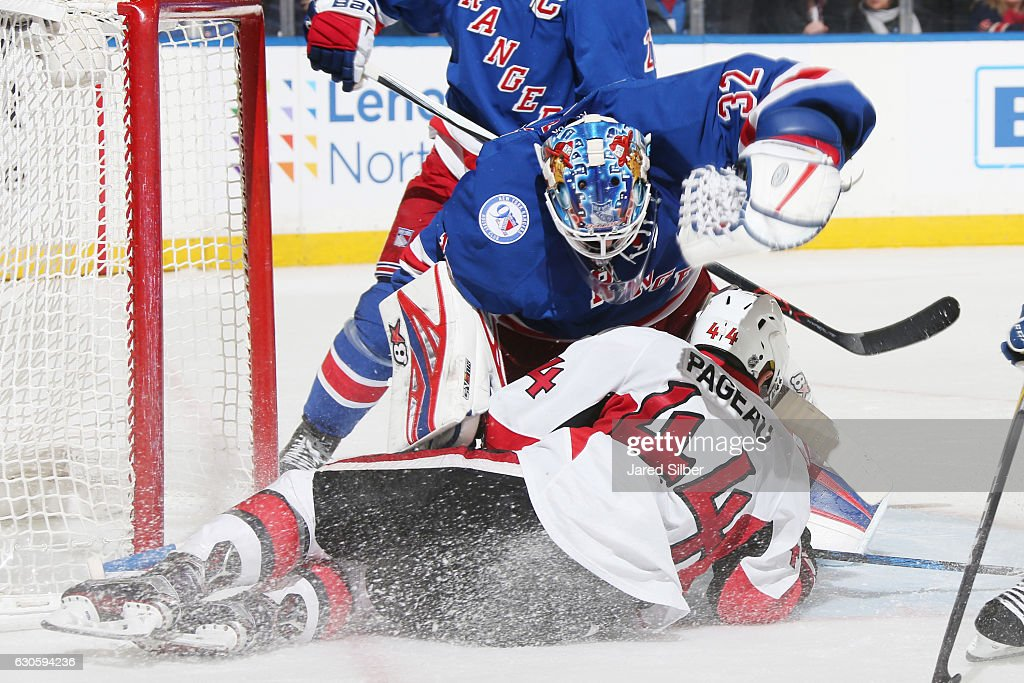 Antti Raanta #32 of the New York Rangers reacts after being run into by Jean-Gabriel Pageau #44 of the Ottawa Senators at Madison Square Garden on December 27, 2016 in New York City.