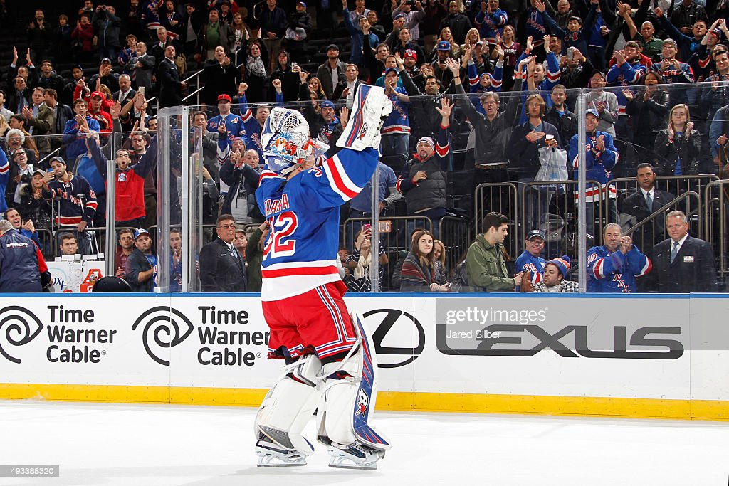 Antti Raanta #32 of the New York Rangers salutes the crowd after being named the first star of the game against the San Jose Sharks at Madison Square Garden on October 19, 2015 in New York City.