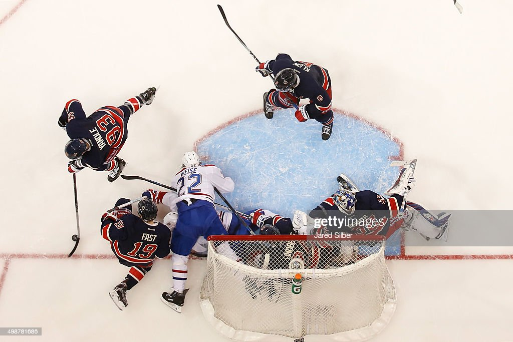 Antti Raanta #32 of the New York Rangers scrabbles to get back to the net as a pile up ensues at the net against the Montreal Canadiens at Madison Square Garden on November 25, 2015 in New York City.