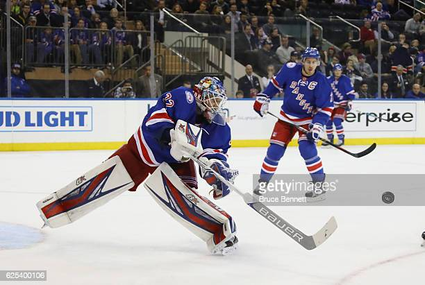 Antti Raanta of the New York Rangers shoots the puck to the boards during the third period against the Pittsburgh Penguins at Madison Square Garden...