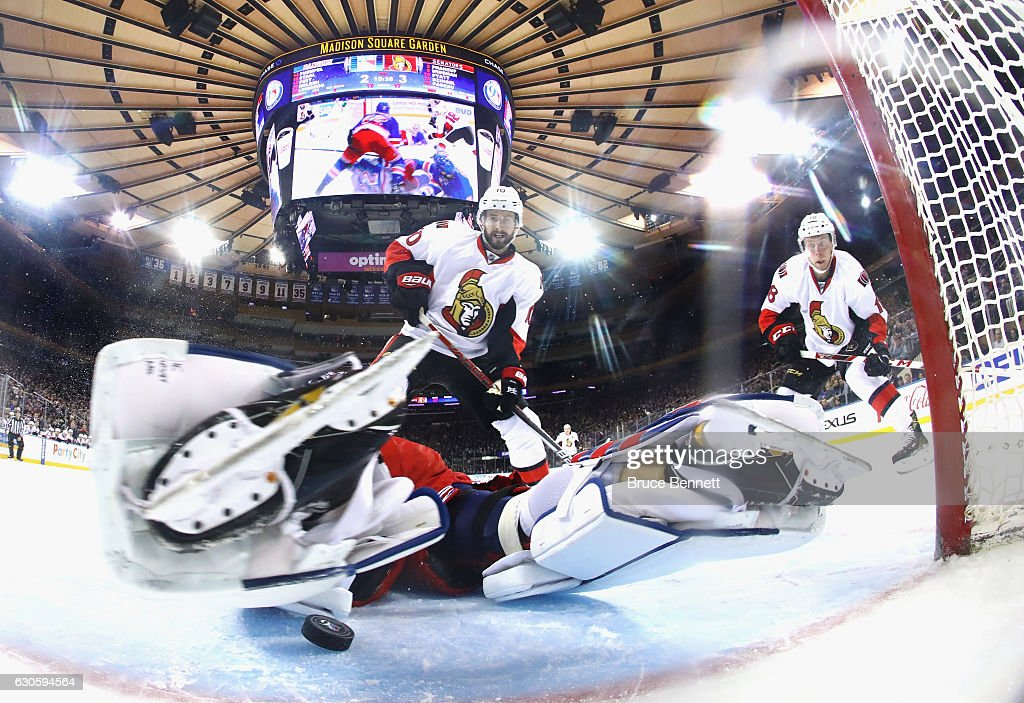 Antti Raanta #32 of the New York Rangers stops Tom Pyatt #10 and Ryan Dzingel #18 of the Ottawa Senators during the second period at Madison Square Garden on December 27, 2016 in New York City. The Rangers defeated the Senators 4-3.
