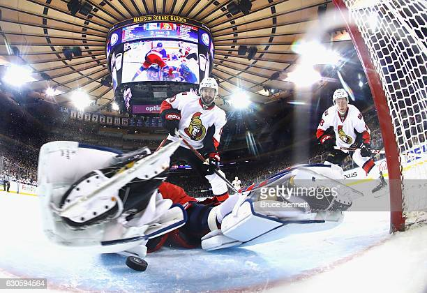 Antti Raanta of the New York Rangers stops Tom Pyatt and Ryan Dzingel of the Ottawa Senators during the second period at Madison Square Garden on...