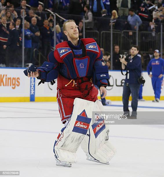 Antti Raanta of the New York Rangers throws tshirts to fans following the Rangers final regular season game against the Detroit Red Wings at Madison...