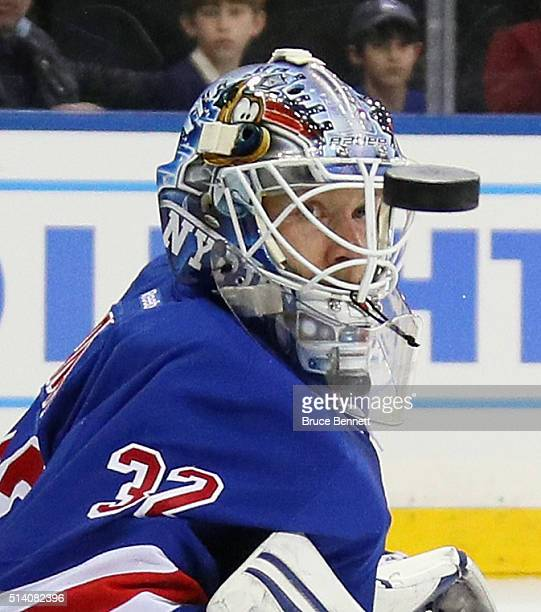 Antti Raanta of the New York Rangers watches a first period shot sail past him against the New York Islanders at Madison Square Garden on March 6...