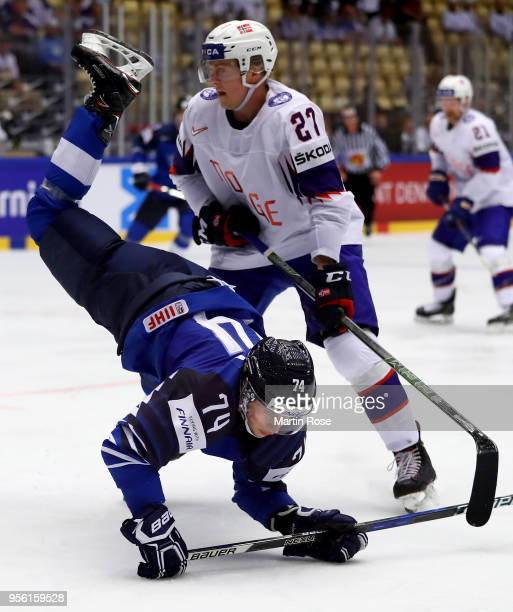 Antti Suomela of Finland and Ludvig Hoff of Norway battle for the puck during the 2018 IIHF Ice Hockey World Championship group stage game between...
