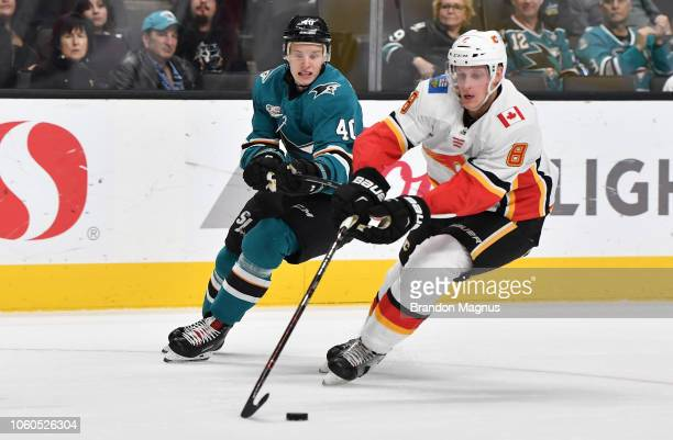 Antti Suomela of the San Jose Sharks battles for the puck with Juuso Valimaki of the Calgary Flames at SAP Center on November 11 2018 in San Jose...
