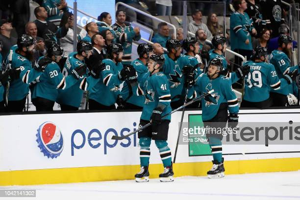 Antti Suomela of the San Jose Sharks is congratulated by teammates after he scored a goal in their preseason game against the Calgary Flames at SAP...