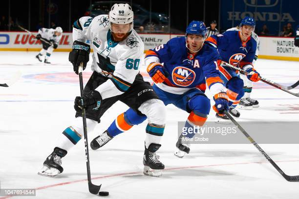 Antti Suomela of the San Jose Sharks makes an offensive attack against Cal Clutterbuck of the New York Islanders during the second period at Barclays...