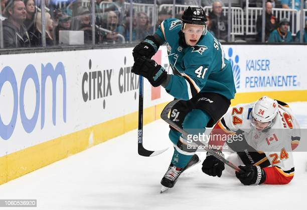 Antti Suomela of the San Jose Sharks skates ahead of Travis Hamonic of the Calgary Flames at SAP Center on November 11 2018 in San Jose California