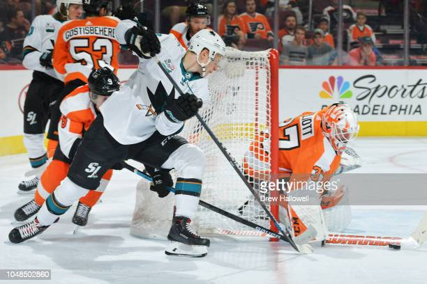 Antti Suomela of the San Jose Sharks tries to backhand the puck past Brian Elliott of the Philadelphia Flyers at the Wells Fargo Center on October 9...