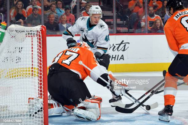 Antti Suomela of the San Jose Sharks tries to jam the puck past Brian Elliott of the Philadelphia Flyers at the Wells Fargo Center on October 9 2018...